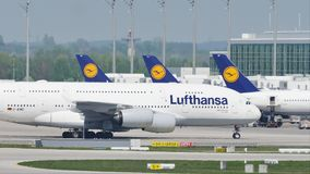 Lufthansa A380 plane doing taxi on runway, close-up stock video