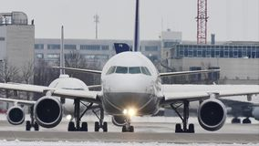 Lufthansa plane lineup in Munich Airport, snow on runway. Lufthansa lineups on snow in Munich Airport, MUC, Germany stock video