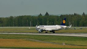 Lufthansa plane landing and Delta airplane taxiing in Frankfurt Airport, FRA stock video footage