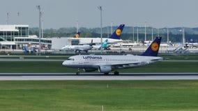 Lufthansa plane landing in Munich Airport, MUC. Plane spotters watching stock video