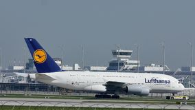 Lufthansa A380 plane taxiing in Munich Airport, snow. Lufthansa jet heading to terminal gate in Munich Airport, Germany stock footage