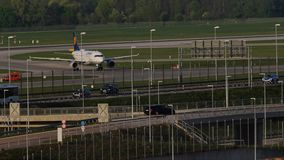 Lufthansa plane taxiing in Munich Airport, spring. Lufthansa plane doing taxi in Munich Airport, MUC stock footage