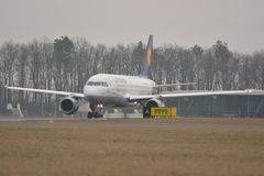 Lufthansa plane. This is a view of Lufthansa plane Airbus A319-114 registered as D-AILS. February 19, 2015. Lublin Airport in Swidnik, Poland Royalty Free Stock Images