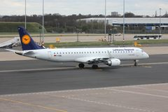 Lufthansa Regional. BIRMINGHAM, UK - APRIL 24, 2013: Pilots taxi Lufthansa Embraer ERJ-195 at Birmingham Airport, UK. Lufthansa carried 103 million passengers in Stock Image