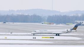 Lufthansa Regional plane gets ready to takeoff at Munich Airport, Germany. Lufthansa Regional is a brand name for regional and feeder flights performed by two stock video footage
