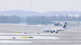Lufthansa Regional plane gets ready to takeoff at Munich Airport, Germany. Lufthansa Regional is a brand name for regional and feeder flights performed by two stock footage