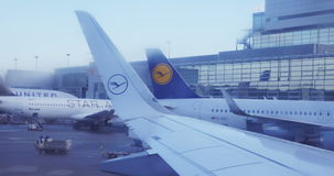 Lufthansa wings in airport seen through frosted window stock footage