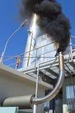 Luftverschmutzung verursacht durch einen Ableiter Stockfoto