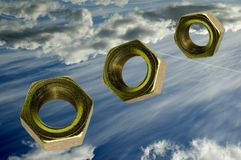 Lug nuts. Concept for ideas for bolts out of the blue. Lugnuts falling from the sky stock photography