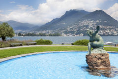 Lugano bay with statue Stock Photography