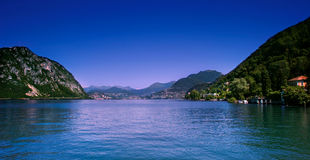 Lugano city and lake. Scenic view of Lugano city shoreline and lake, Ticino, Switzerland Royalty Free Stock Images