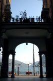 Lugano, the city and the lake. The lake of lugano through arch in the center of the city Stock Image