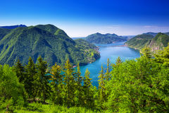 Lugano city, Lugano lake and Monte San Salvatore from Monte Bre, Ticino, Switzerland. View to Lugano city, Lugano lake and Monte San Salvatore from Monte Bre Royalty Free Stock Photo