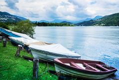 Lugano Lake, boats at rest on the grass Royalty Free Stock Image