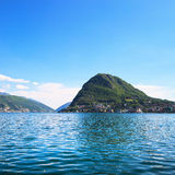 Lugano lake and mountains landscape. Ticino, Swiss, Europe. Stock Photos