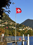 Lugano Lake Swiss flag in Switzerland Royalty Free Stock Image
