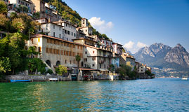 Lugano lake in Switzerland. View on shore with buildings Stock Photo