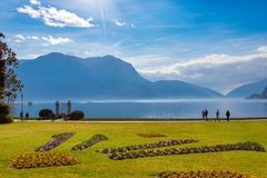 Beautiful picturesque view on the Lake Lugano and Swiss alps. The town of Lugano is on the shore of Lake Lugano in the Italian speaking Ticino part of royalty free stock photo