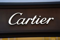 LUGANO, SWITZERLAND - NOVEMBER 27, 2017: Cartier signboard. Cartier is a French luxury goods conglomerate company. stock photos