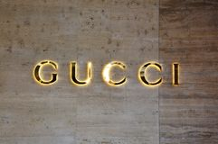 LUGANO, SWITZERLAND - NOVEMBER 27, 2017: flared sign of Gucci. Gucci is an Italian fashion and leather goods brand founded by Gucc. Io Gucci in Florence in 1921 Stock Images