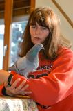 Girl with a pigeon at the animal shelter. Lugano, Switzerland - 19 November 2002: girl with a pigeon at the animal shelter of Lugano on Switzerland stock photos