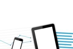 Lugar de trabajo con los dispositivos de Digitaces y las cartas financieras imagen de archivo libre de regalías