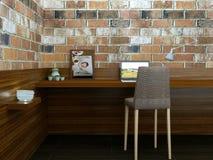 Lugar de trabajo moderno acogedor con las paredes de ladrillo tabla, PC, silla y decoración Fotos de archivo