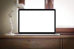 Lugar de trabalho com o caderno na mesa Imagem de Stock
