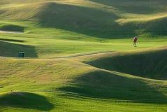 Lugar e por do sol do golfe fotografia de stock