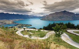 Luge track with beautiful lake and mountain Stock Image