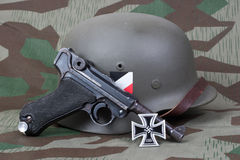 Luger P08 Parabellum handgun, helm and medal Iron Cross Royalty Free Stock Photos