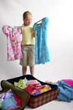 Luggage. Little girl packing Stock Photo