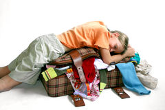 Luggage. Young  girl packing Stock Images