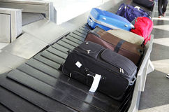 Luggage. Suitcases on a luggage band on the airport Stock Image