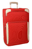 Luggage. Red suitcase with the handle on a white background Stock Photography