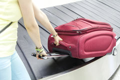 Luggage in airport conveyor belt Royalty Free Stock Photo