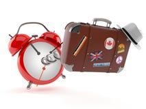 Luggage with alarm clock. Isolated on white background Stock Images