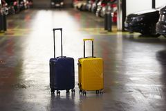 Luggage bag on the city street ready to pick by airport transfer taxi car. royalty free stock photos