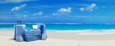 Luggage at the beach. Pile of baggage on a tropical beach Royalty Free Stock Photography