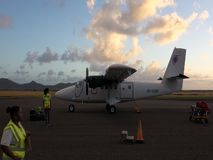 Luggage being removed from a twin otter at an airport in the grenadines. A passenger plane preparing to depart from bequia in the caribbean stock video footage
