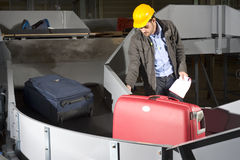 Luggage belt worker Royalty Free Stock Photo