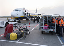 Luggage and bicycles waiting for boarding ryanair airplane on ei Royalty Free Stock Image