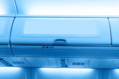 Luggage box. In the cabin of the airplane Royalty Free Stock Photos