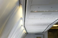 Luggage cabin airplane Stock Images