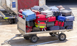 Luggage Cart. At the airport full of colorful suitcases Royalty Free Stock Image