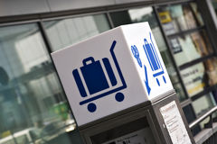 Luggage cart renting point at airport Royalty Free Stock Photography