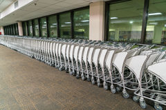 Luggage carts at airport terminal . Royalty Free Stock Photography