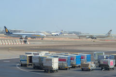 Luggage carts in the background the airfield of the international airport of Abu Dhabi Royalty Free Stock Image