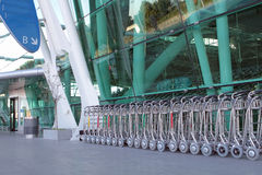Luggage carts. At an international airport entrance Royalty Free Stock Image