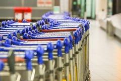 Luggage carts at modern international airport Royalty Free Stock Photos